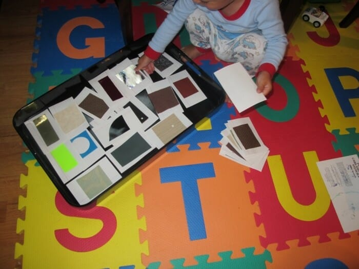 A child playing a sensory game with textures
