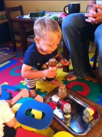 A child smelling spices