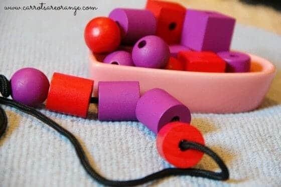 3 Fun & Easy to Put Together Montessori Valentine's Day Activities - Valentine Bead Stringing