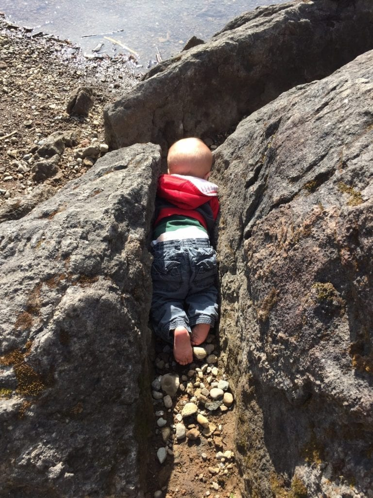 A child exploring the rocks
