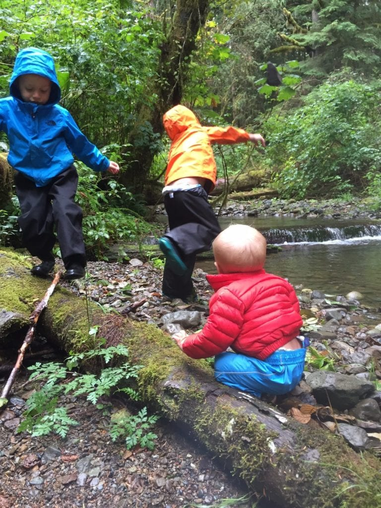 Boys playing by a creek