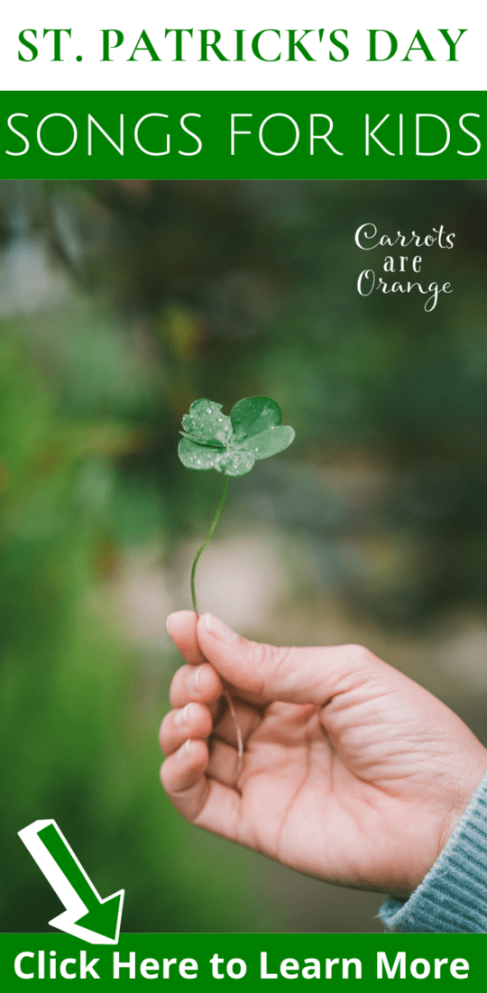 A person holding a four leaf clover
