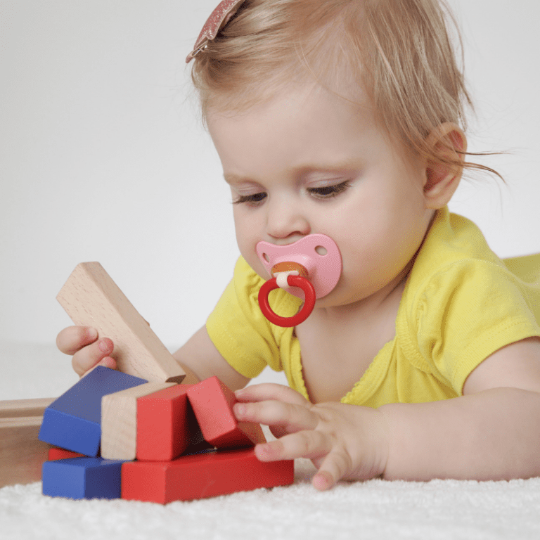A baby playing with blocks