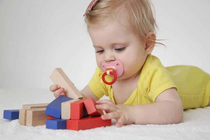 picture of baby playing with montessori toys
