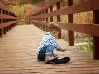 Canva Boy Sitting on Wooden Dock scaled